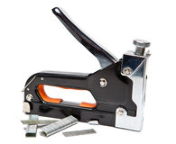 Metal stapler and brackets in a holder for repair work on the house Royalty Free Stock Photography
