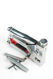 Metal stapler futniture tool with ammunition on the white background Royalty Free Stock Photos
