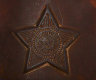 Metal star brown background Royalty Free Stock Photo