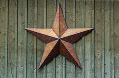 Metal Star On Wood Wall Royalty Free Stock Photo
