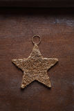 Metal star on the wooden background Royalty Free Stock Image