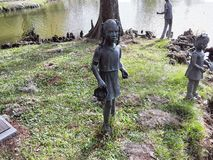A metal statue of average side girl. royalty free stock image