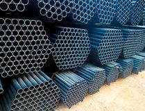 Metal steel and aluminium pipe heap in the cargo warehouse for transportation and logistics to the manufacturing factory stock photo