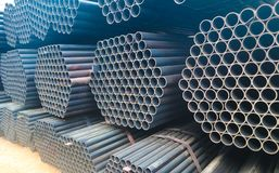 Metal steel and aluminium pipe heap in the cargo warehouse for transportation and logistics to the manufacturing factory royalty free stock image
