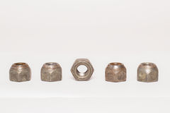 Metal and steel nuts on white background. Several metal and steel nuts on white background Royalty Free Stock Photos