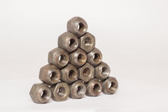 Metal and steel nuts on white background. Several metal and steel nuts on white background Royalty Free Stock Images