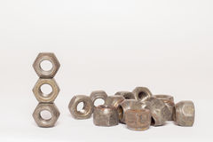 Metal and steel nuts on white background. Several metal and steel nuts on white background Stock Photography
