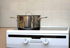 Metal steel saucepan on modern kitchen electric stove Stock Images