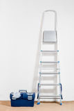Metal stepladder and a tool box Royalty Free Stock Image