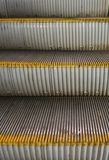 Metal steps of an escalator stock image