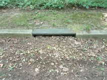 Metal storm drain. Iron metal storm drain for water on the ground Stock Photos