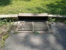 Metal storm drain. Iron metal storm drain for water on the ground Stock Image