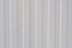 Metal striped gray fence. Stock Photo