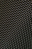 Metal structure. Meshy metal structure background on the black Stock Photography
