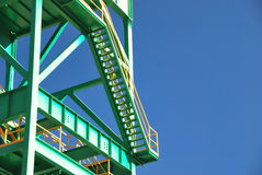 Metal structure. Close-up of a mine tower over a blue sky Stock Photos