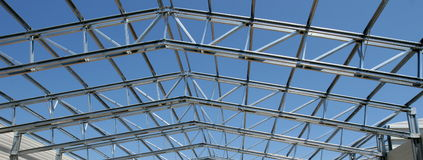 Metal structure. Metalic net structure under blue sky royalty free stock photo