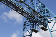 Metal structure of the crane, against the sky, in the warehouse Royalty Free Stock Photography