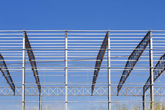 Metal structure of industrial warehouse Stock Photos