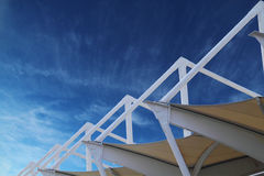 Metal structure with nylon canvas. Metal building structure with nylon canvas and clear blue sky Stock Photography