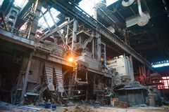 Old abandoned metallurgical plant. Metal structures and buildings of the old metallurgical plant inside and outside royalty free stock photo