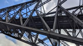 Metal structures of the Quebec Bridge. Road and rail bridge that crosses the St. Lawrence River royalty free stock photos