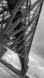 Metal structures of the Quebec Bridge. Road and rail bridge that crosses the St. Lawrence River royalty free stock photography