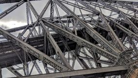 Metal structures of the Quebec Bridge. Road and rail bridge that crosses the St. Lawrence River stock photo