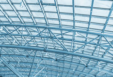 Metal structures on the roof of the shopping complex background. Toning Stock Image