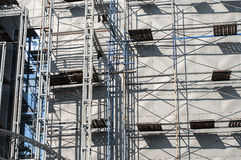 Metal structures on the wall. Metal construction with scaffolding on the wall of the new building Royalty Free Stock Image