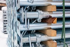 Metal supports for construction formwork. Metal structures in a warehouse in stacks. metal supports for scaffolding and formwork. soft focus and bokeh.Outdoors stock image