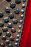 Metal stud on leather chiness drum Stock Photo