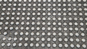 Metal studded flooring with one missing piece Stock Photos