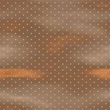 Metal studs on copper texture Stock Image