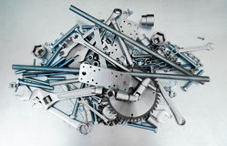 Metal style. Many tools on the scratched metal Stock Image