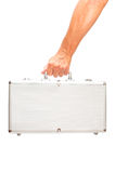 Metal suitcase in hand Royalty Free Stock Image