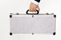 Metal suitcase. On a white background, hand held Royalty Free Stock Image