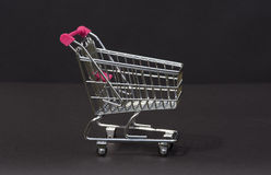 A metal supermarket trolley in miniature Stock Photo