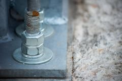 The metal support is bolted to the concrete block. Is close royalty free stock images