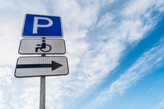 Metal support with traffic signs parking place, right signboard, sign of a place for the disabled against a blue sky Royalty Free Stock Image