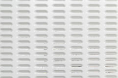 Metal surface with air vent perforation Stock Images
