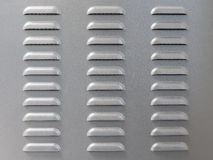 Metal surface with air vent perforation. For background Stock Image