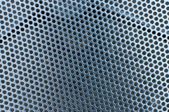 Metal surface with circular holes, texture Royalty Free Stock Image