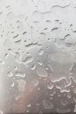 Metal surface covered in water drops. Royalty Free Stock Photo