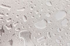 Metal surface covered in water drops. Stock Images