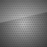 Metal surface, dark gray background perforated sheet Royalty Free Stock Photography