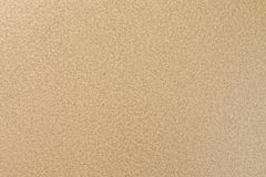 Metal surface in golden color with porous heterogeneous texture Royalty Free Stock Photography