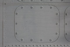 Metal surface with hatch. Gray metal surface with a hatch on the bolt Royalty Free Stock Photography