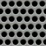 Metal surface with holes. (With Clipping Path Royalty Free Stock Photos