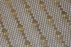 Metal surface with holes Royalty Free Stock Photos