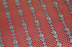 Metal surface with holes Stock Image